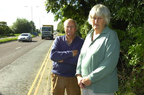 George and Muriel Walton are calling for a single carriageway alongside Caen Hill Road