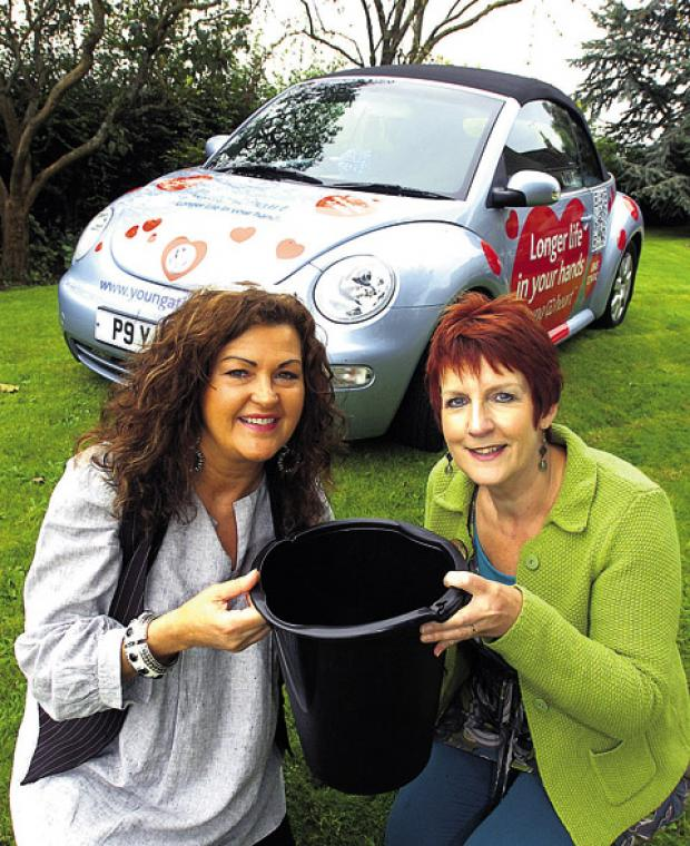 HEALS co-directors Amanda Richards and Elaine Godley with the charity's sponsored VW Beetle     (39882) Paul Morris