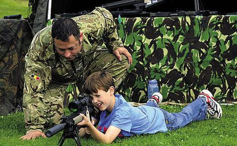 Thomas, 11, gets instructions from WO2 John Wilson