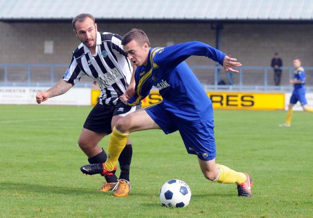 Bassett's Adam Corcoran in action on Saturday