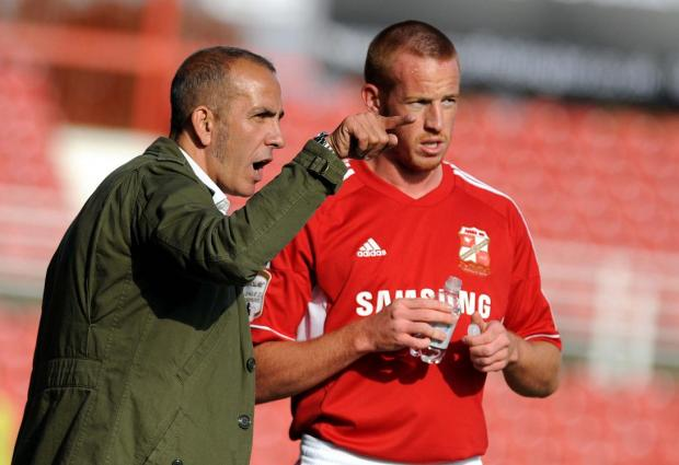The Wiltshire Gazette and Herald: STAYING ON?: Adam Rooney, right, with Paolo Di Canio