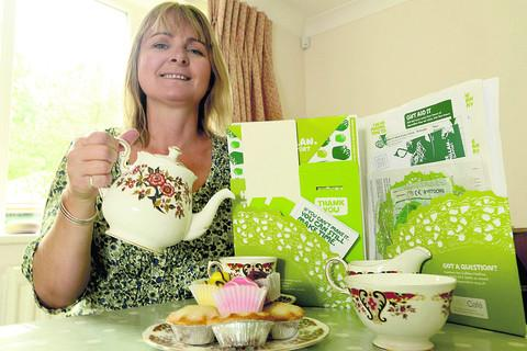 Rachel Biffen prepares her Macmillan World's Biggest Coffee Morning event