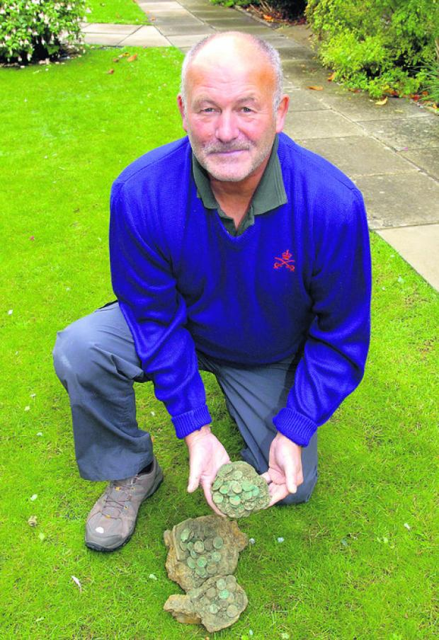Tony Mims with the 4th-century Roman coins he found near Malmesbury