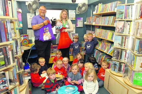 Library manager Steve Taylor and Rachael Page, from Malmesbury Children's Centre, with youngsters and their Storysacks