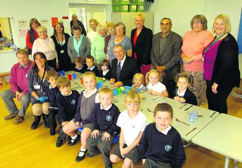 Coun John Thomson, centre, with residents and pupils, at the launch of the lunch club