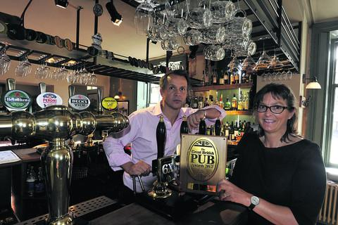 Martin and Debbie Still, of the Methuen Arms, with their Great British Pub award