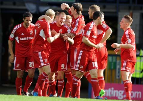 Swindon Town's player celebrate James Collins' strike against Bury