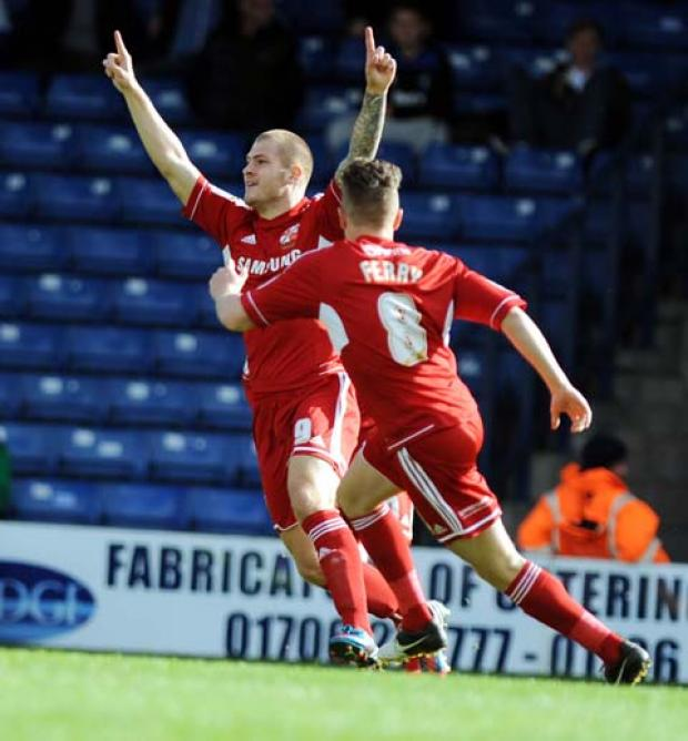 Swindon Town's James Collins celebrates his goal with Simon Ferry