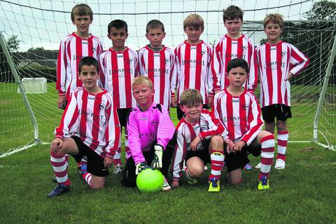 Devizes Town U10s wearing their new kit, which has been provided by Norman Roberts from the fish-and-chip shop Lemon Plaice
