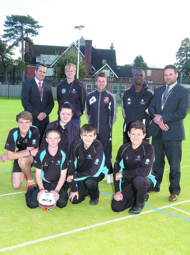 On the school's new artificial playing surface are, back row from left, Trystan Williams, Mike Thomas, Jeremy Newton, Marvin Brown, James Lynch; front, Cory, Emily, Ethan, George and Matthew