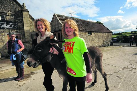Volunteers Sophie and Annie with Ellie the donkey