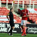 Swindon Town's Aden Flint sees red on Saturday