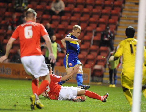 The Wiltshire Gazette and Herald: WASTED CHANCES: Jay McEveley fails to find a way through against Crewe