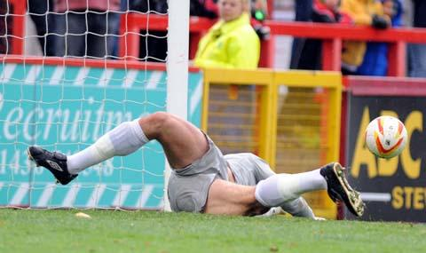Tommy Miller's penalty is saved by Stevenage's Steve Arnold during Swindon Town's 4-0 win on Saturday