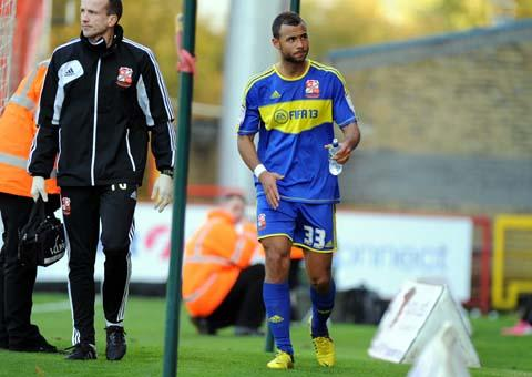 Swindon Town's John Bostock leaves the field at Stevenage with a groin injury