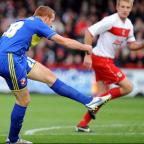 The Wiltshire Gazette and Herald: Adam Rooney scores for Swindon Town at Stevenage