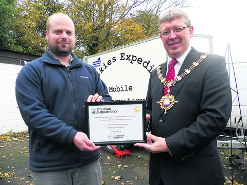 Greenacres' senior supervisor Jonathan Baker receives the It's Your Neighbourhood certificate from Mayor Kelvin Nash