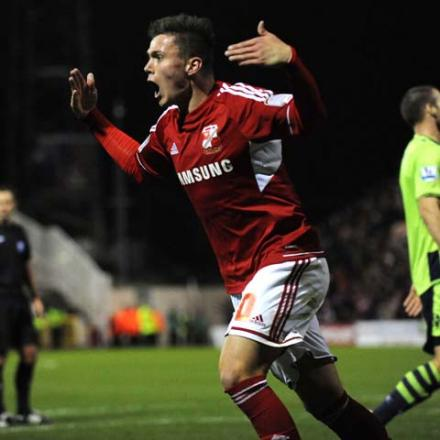 Swindon Town's Miles Storey scores against Aston Villa