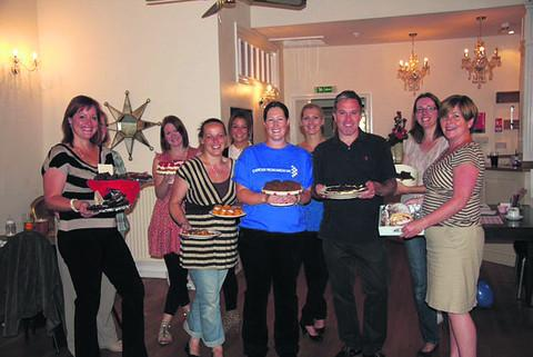 Mel Cook, Helen O'Brien, Mel Weeks, Stacie Willis, Jessica Hancock, Jacqueline Muttock, Steve Chadwick, Mel Pitman and Catherine Chadwick with their array of cakes