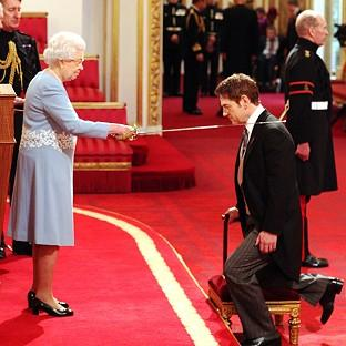 Actor Kenneth Branagh receives a knighthood from the Queen