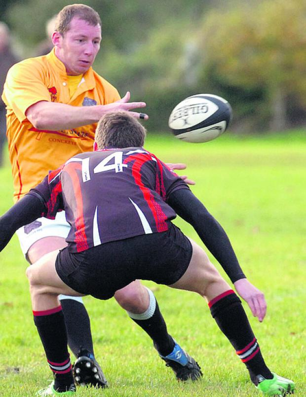The Wiltshire Gazette and Herald: Devizes John Angell on the attack during his side's win over Sherborne last weekend