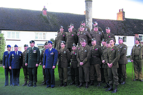 Members of the Screaming Eagles on The Green, Aldbourne, with Lt Col Mark Houston (in green), a serving officer in the 506 Parachute Infantry Regiment, and three USAF officers following the Remem