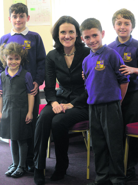Northern Ireland Secretary Theresa Villiers with pupils at Springfields Academy
