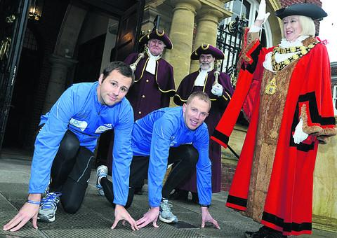The Wiltshire Gazette and Herald: PC Adam Leakey and PC John Hewlett get their three marathons in three days underway being started by Edwina Fogg, Marlborough's mayor, and mace bearers David Snelgrove and David Sherratt