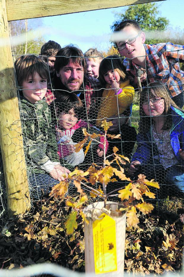 Villagers celebrate the planting of an oak in The Nymph Hay wood