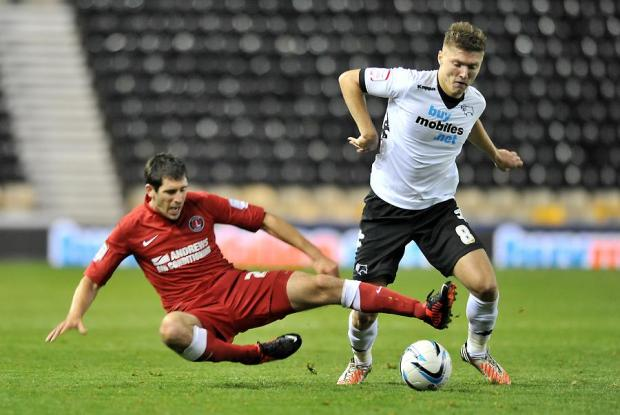 Hollands (right) tackles Jeff Hendrik of Derby County