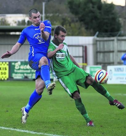 Chippenham Town's Lee Phillips battles with Bedworth United's Nathan Haines in last Saturday's 1-1 draw at Hardenhuish Park