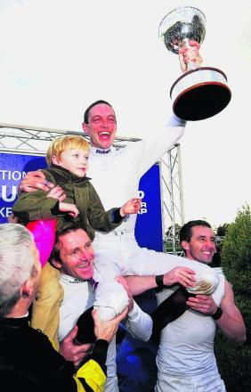 Richard Hughes celebrates his title win with son Harvey at Doncaster on Saturday