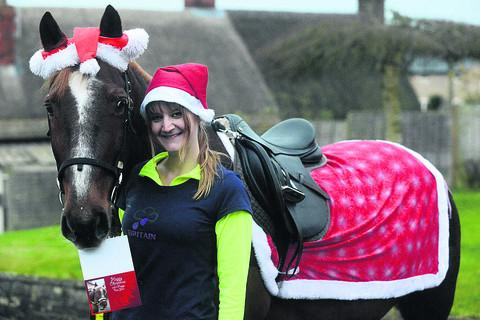 Ginette Stewart and her trusty steed Sam get ready to deliver festive cards