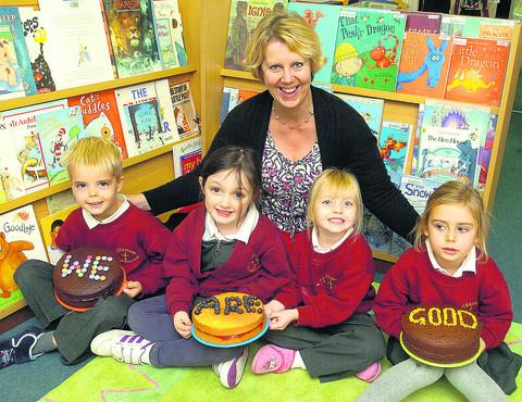 Headteacher Sue Chivers with Alister, Sky, Lily and Annabelle celebrate the school's good Ofsted report
