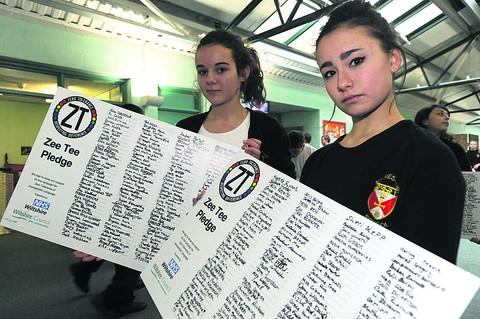 Katie Mitchell and Oceanne Chin with the anti-homophobic language pledge created as part of Malmesbury School's crackdown on bullying