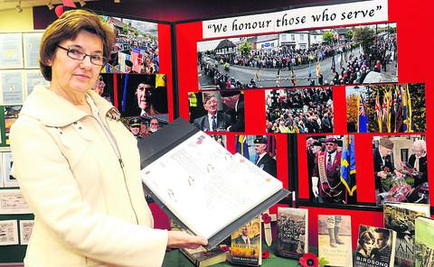Royal Wootton Bassett deputy mayor Linda Frost with letters sent to Royal Wootton Bassett during repatriations. They are on display at the town's library
