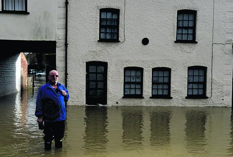 Terry Soule outside his daughter's flooded home