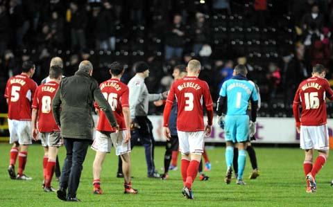 The Wiltshire Gazette and Herald: Swindon Town trudge off the pitch at Meadow Lane after their defeat to Notts County