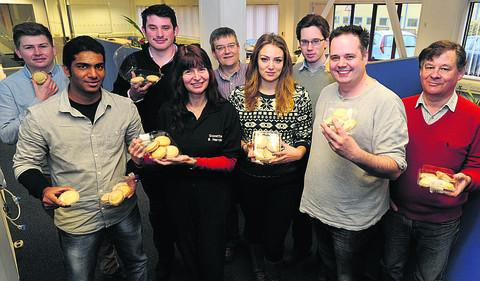 Arkivum staff receive their mince pies. Back row, Harry Bloice, Ben Thomas, John Woodriff, Richard Lowe, Graham Steele, front, Valencio Perira, Dawn Dimmer, Jenny Cook and Gareth Brown