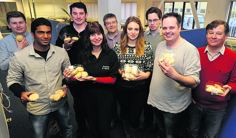 Arkivum staff receive their mince pies. Back row, Harry Bloice,