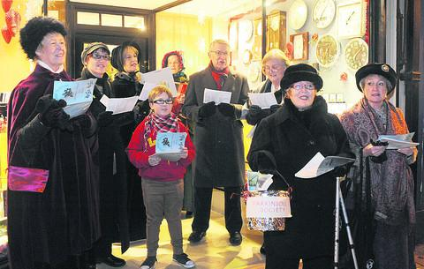 Carol singing at last year's late night shopping evening in Malmesbury