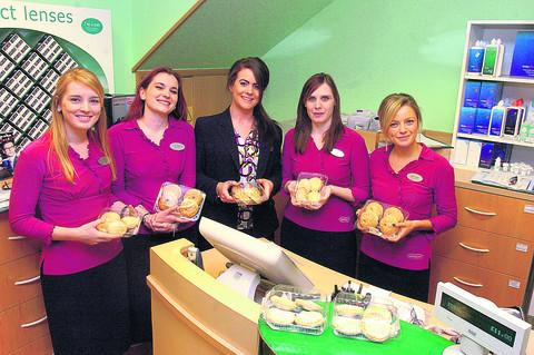 The Wiltshire Gazette and Herald: TUCKING IN: Devizes Specsavers mince pie winners Clare Pocock, left, Lauren McAlpine, Polly Seager and manager Kirsty Muspratt. They were all given mince pies by the Gazette
