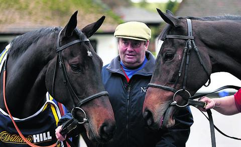 Trainer Nicky Henderson with Long Run (left) and Finian's Rainbow (right) at his Seven Barrows stables, in Lambourn, yesterday