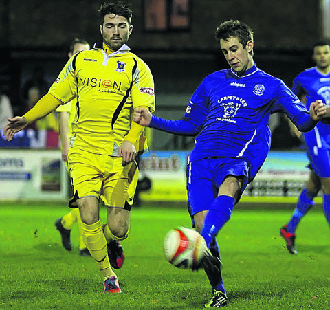 Chippenham Town's James Guthrie clears as ex-Bluebirds man Jon Davies closes in on Tuesday night (Picture by Robin Foster)