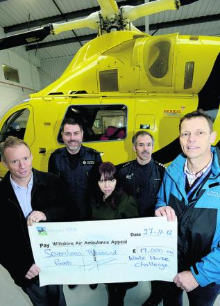 Richard Edwards and Zoe Meaden of Monahans and Clive Milner of Rocking Horse Nursery present the cheque to Nigel Gilbert and Rob Backus of the Air Ambulance