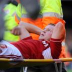 The Wiltshire Gazette and Herald: Swindon's Alan Navarro suffers his latest injury against Coventry