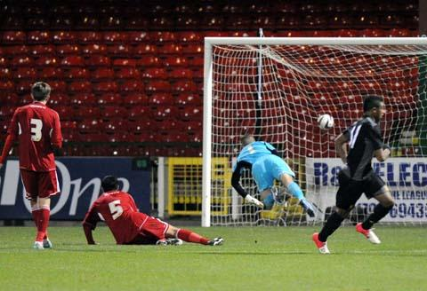 Liverpool's Jerome Sinclair scores against Swindon Town in the FA Youth Cup last night