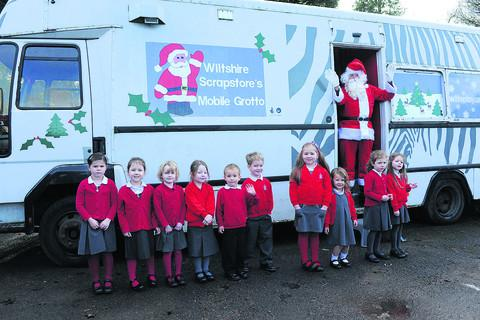 Derrry Hill Primary School pupils welcomed by Father Christmas at the launch the Scrapstore mobile grotto