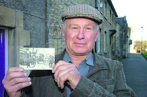 The Wiltshire Gazette and Herald: Farmer Keith Potter with the postcard delivered in 2012 but posted in 1912
