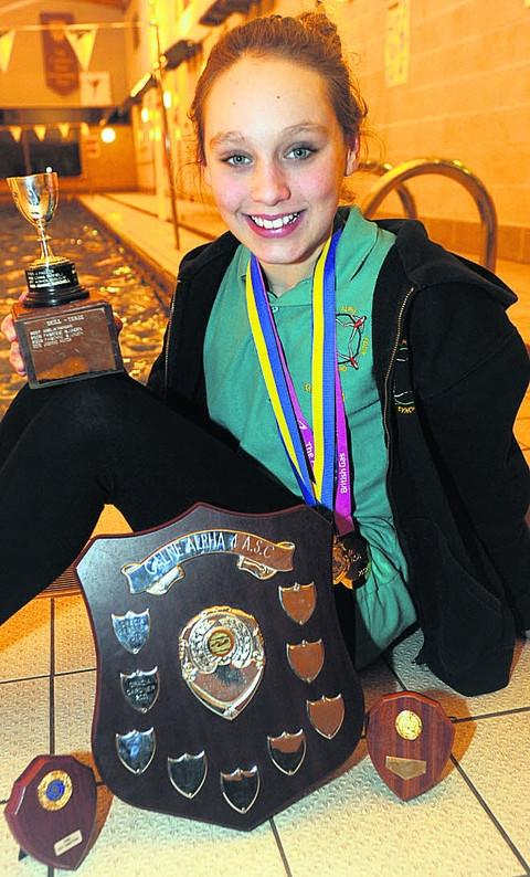 Graccia Gardner shows off some of her recent medals and trophies